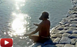 A Swami from the Saiva tradition, taking a dip at the Kumbh Mela (India)